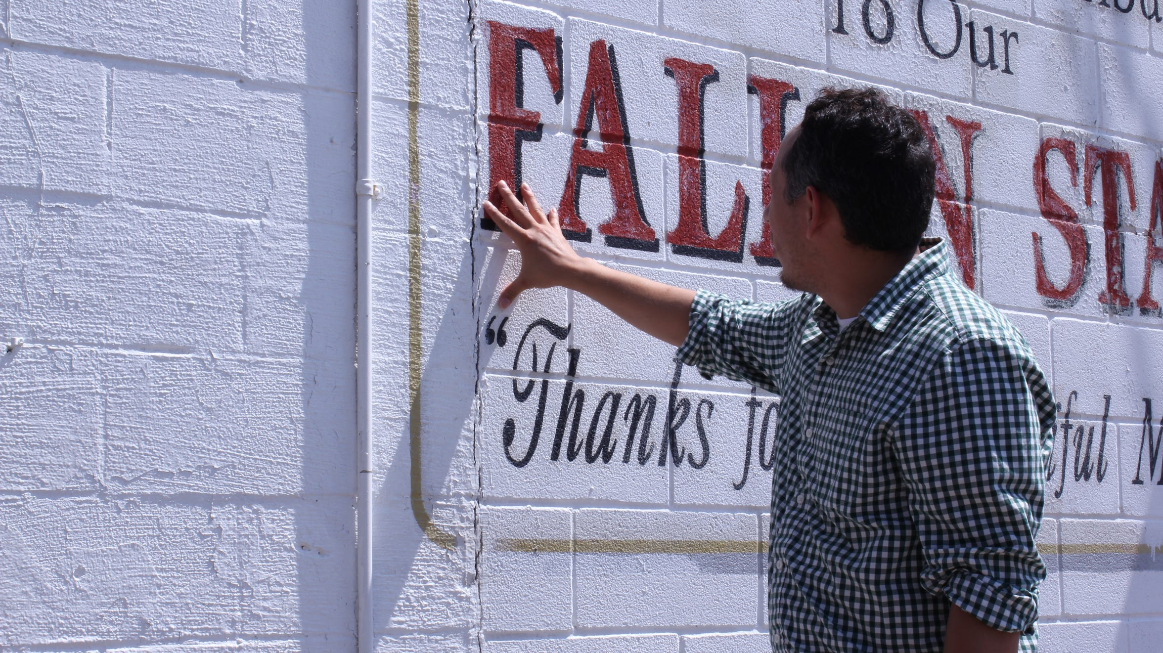 Eric Tunchez shows the wear and tear of the Selena mural located in the Molina neighborhood where she grew up.