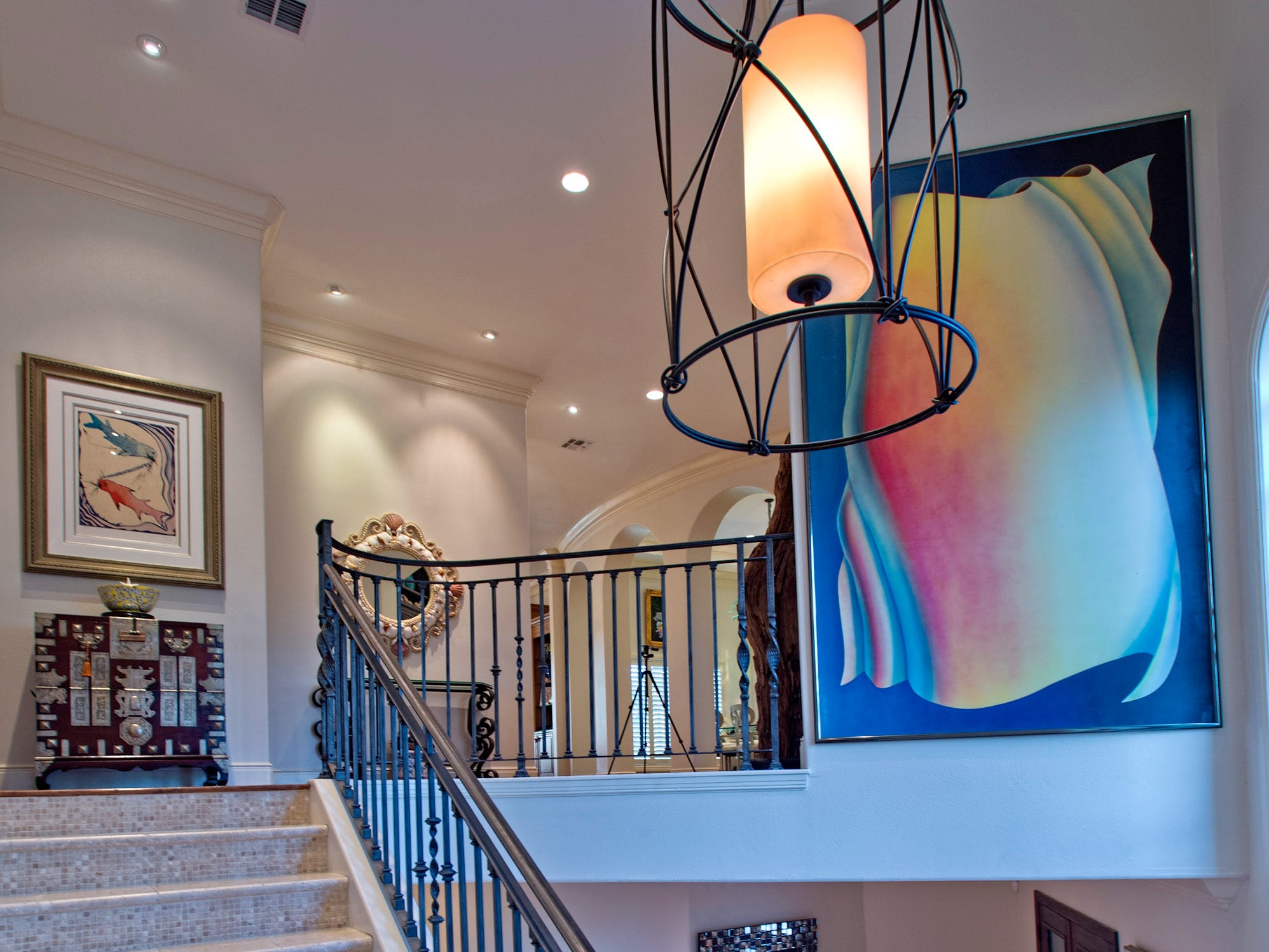 The tiled winding stairway rises up to the second floor living space,.
