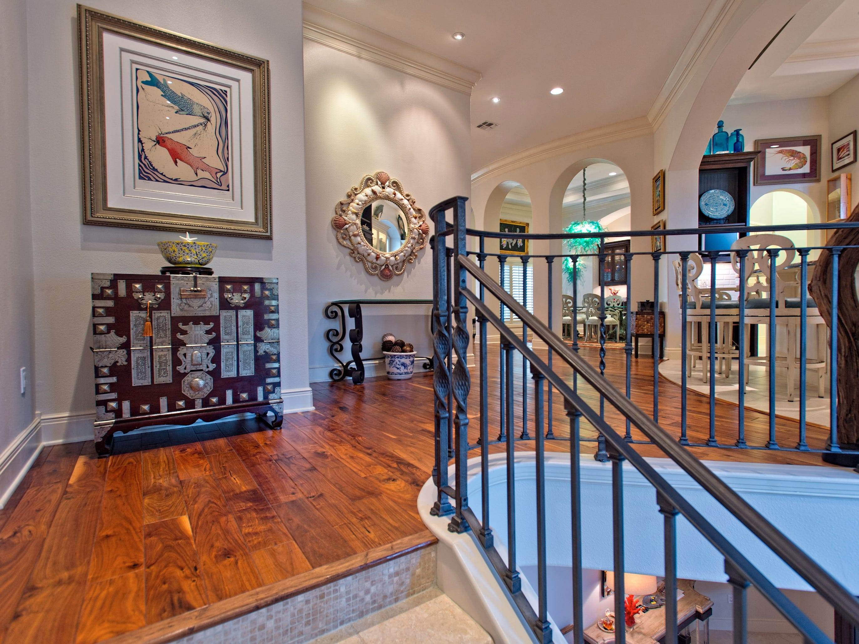 A winding tiled iron railed stair way takes you up to the second floor's generous landing, the kitchen, dinning room and beyond.
