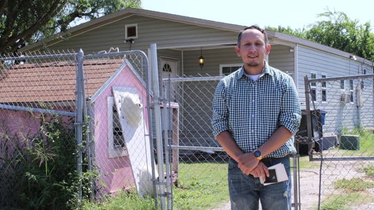 Eric Tunchez stands in front of his childhood home in the Molina neighborhood. He grew up around the corner from Selena's mural on Elvira Drive.