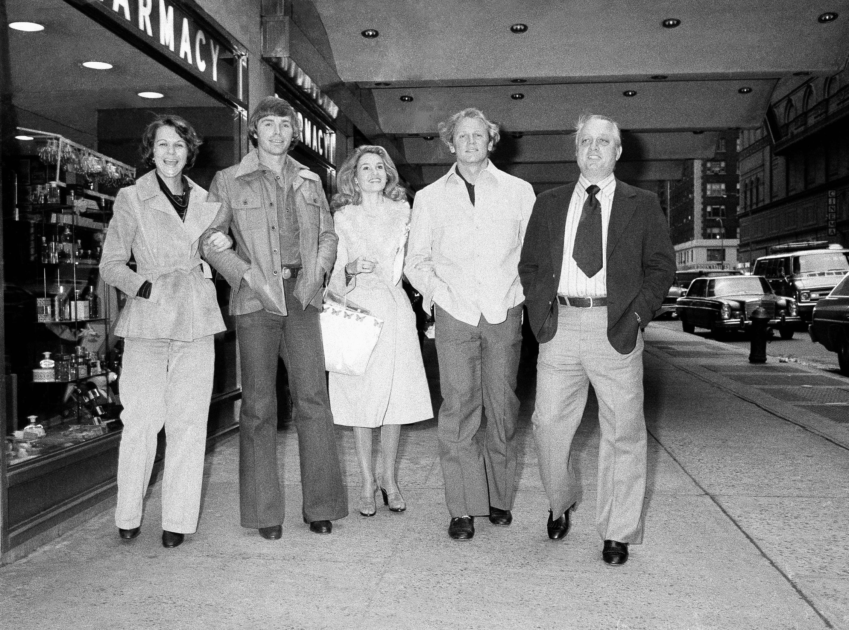 Dodger manager Tommy Lasorda, right, is accompanied by shortstop Bill Russell, second from left, and Russell's wife, Mary Anne and pitcher Burt Hooton, and Hooton's wife, Ginger, on Monday, Oct. 18, 1977 in New York. The group was leaving the Sheraton Hotel in New York City after a news conference. (AP Photo/Marty Lederhandler)