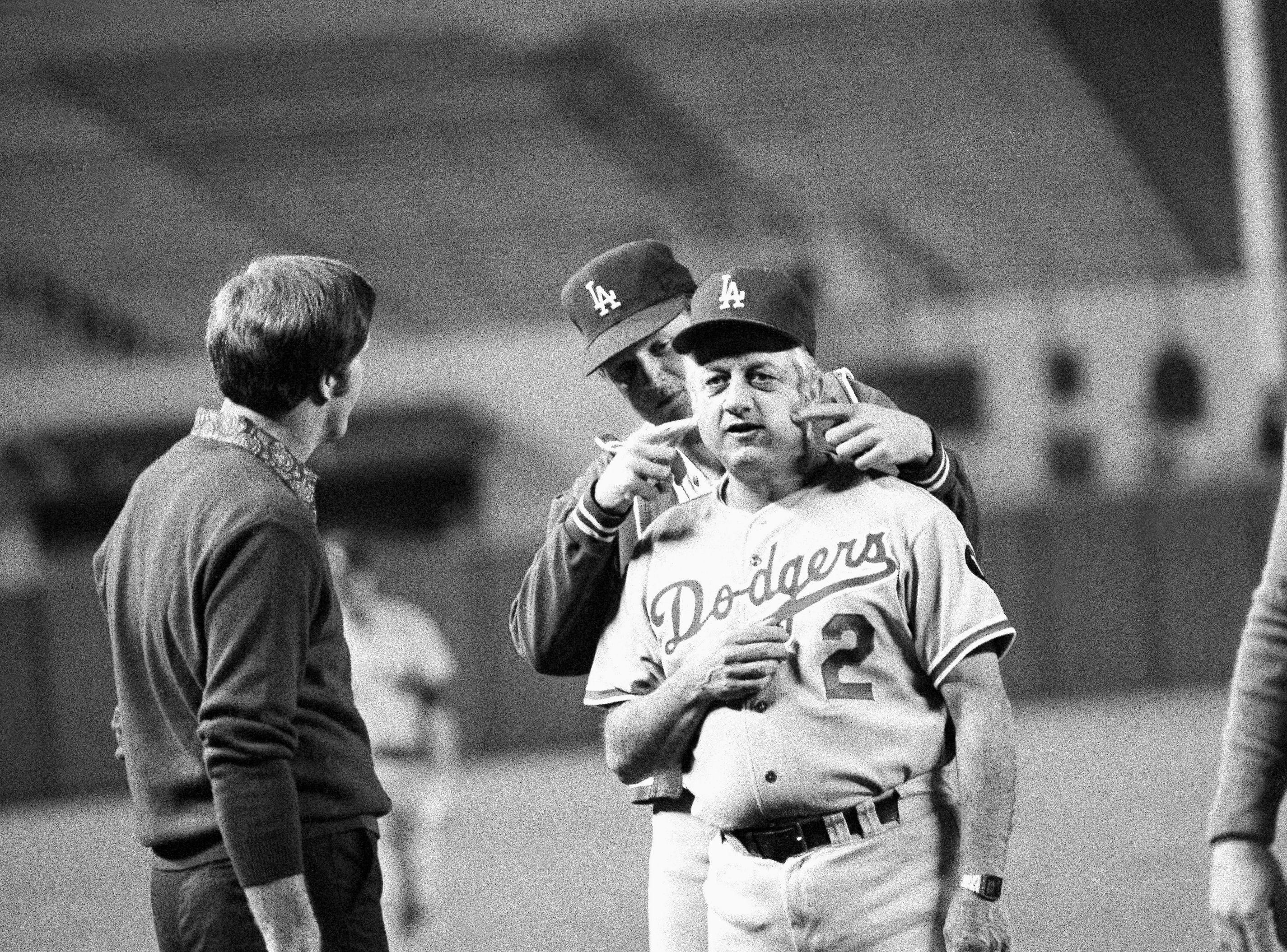 Los Angeles Dodgers Burt Hooton, left, clowns with manager Tom Lasorda during workouts at New York?s Yankee Stadium on Thursday, Oct. 12, 1978 in New York. Hooten is checking to see if Lasorda had enough ?jaw exercises? for Friday?s third World Series game against the New York Yankees. (AP Photo/ John Filo)