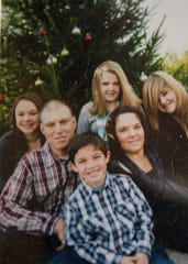 A family picture of Adam Liste with his mom Jennifer, sisters, and stepdad Joe Patterson.