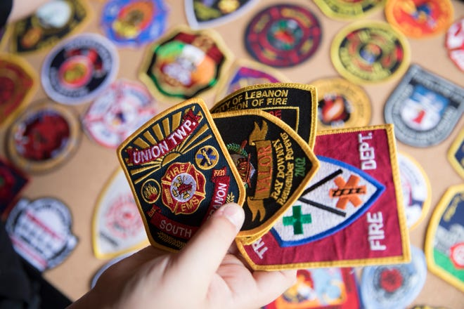 Joe Patterson's stepson shows a few of the numerous patches he has received from around the world. The patches, a birthday surprise to him, was spear headed by  his mother Jennifer Patterson , who put out a request on social media asking for them.