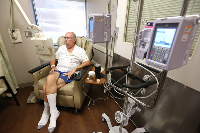 Bob Rulli undergoes an infusion of the experimental drug BXQ-350, which lasted about an hour, Tuesday, July 10, 2018, at the University of Cincinnati's Barrett Cancer Center in Cincinnati.