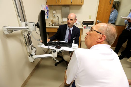 Bob Rulli goes over his MRI scan with Dr. Richard Curry III, his primary neurologist, Tuesday, July 3, 2018, at Good Samaritan Hospital in Clifton.