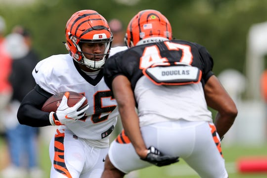 Cincinnati Bengals wide receiver Cody Core (16) turns downfield after making a catch as Cincinnati Bengals linebacker Chris Worley (47) defends during Cincinnati Bengals training camp practice, Wednesday, Aug. 1, 2018, on the practice fields next to Paul Brown Stadium in Cincinnati.