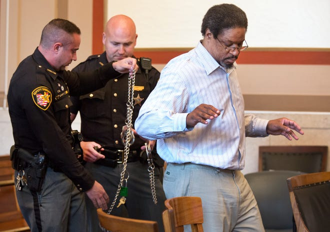 "Handcuffs and shackles are removed from convicted serial killer Anthony Kirkland, 49, after he's brought into the courtroom for his re-sentencing in the deaths of  Casonya ""Sharee"" Crawford, 14, in 2006 and Esme Kenney, 13, in 2009. Once brought in, deputies will take off handcuffs and shackles and Kirkland will put on black dress shoes, a belt and tie. Hamilton Common Pleas Judge Patrick T. Dinkelacker is the presiding judge. Hamilton County Prosecutor Joe Deters is once again asking for the death penalty. Kirkland has admitted killing these two women and three others. In all the cases, he burned their bodies."