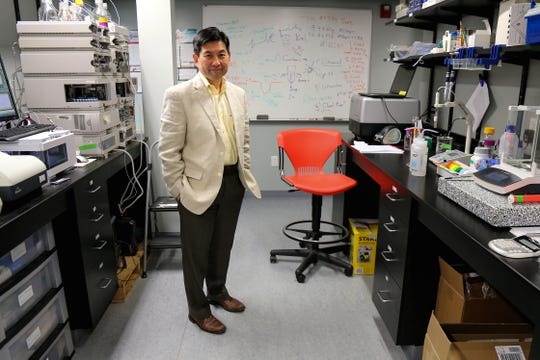 Ray Takigiku, President and CEO of Bexion Pharmaceuticals Inc., stands for a portrait in the company's lab, Thursday, July 5, 2018, Covington, Ky. Bexion Pharmaceuticals Inc. is the developer behind the experimental drug BXQ-350