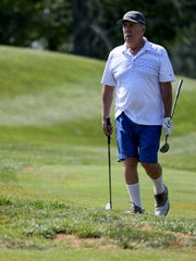 Bob Rulli walks to the green, Wednesday, July 11, 2018, at Lassing Pointe Golf Course in Union, Ky.