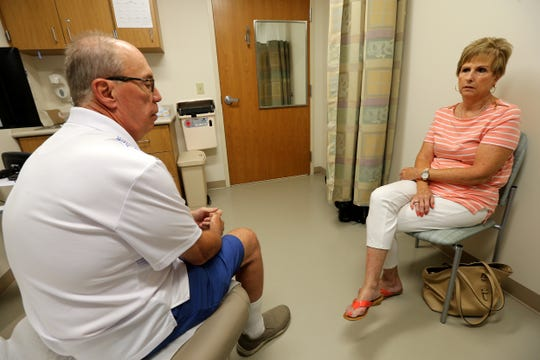 Bob and Elise Rulli talk about Bob's cancer treatment and remaining schedule in the office of Dr. Richard Curry III, Tuesday, July 3, 2018, at Good Samaritan Hospital in Clifton.