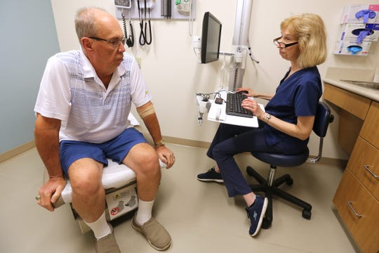 Bob Rulli meets with a nurse at the office of Dr. Richard Curry III for a check-up on his prognosis, Tuesday, July 3, 2018, at Good Samaritan Hospital in Clifton.