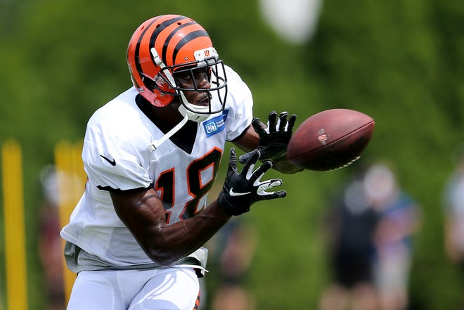 Cincinnati Bengals wide receiver A.J. Green (18) make a catch during Cincinnati Bengals training camp practice, Wednesday, Aug. 1, 2018, on the practice fields next to Paul Brown Stadium in Cincinnati.