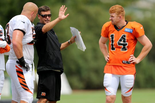 From left: Cincinnati Bengals center Billy Price (53), Cincinnati Bengals offensive coordinator Bill Lazor and Cincinnati Bengals quarterback Andy Dalton (14) talk during Cincinnati Bengals training camp practice, Wednesday, Aug. 1, 2018, on the practice fields next to Paul Brown Stadium in Cincinnati.