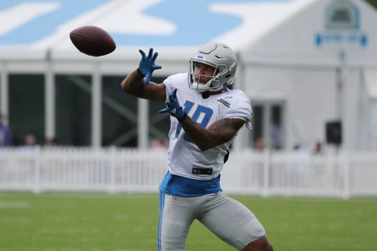 Lions receiver Kenny Golladay catches passes during practice during training camp on Wednesday, Aug. 1, 2018, in Allen Park.