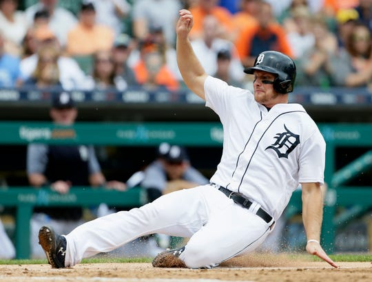 Tigers catcher John Hicks scores on a double by pinch hitter Ronny Rodriguez during the sixth inning of the Tigers' 7-4 win over the Reds on Wednesday, Aug. 1, 2018, at Comerica Park.