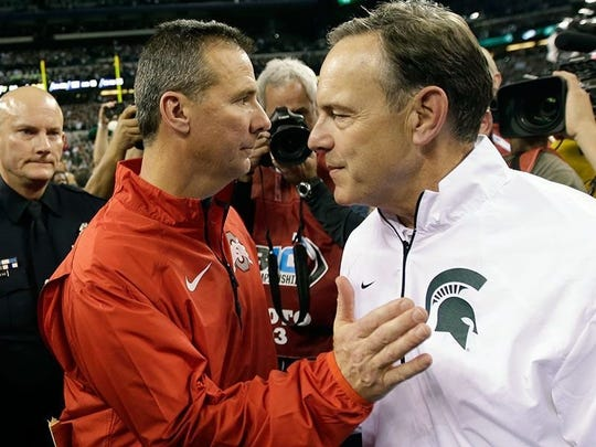 Urban Meyer, left, and Mark Dantonio meet, after the Spartans beat the Buckeyes in the 2013 Big Ten championship game.