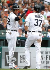 Tigers right fielder Victor Reyes, left, celebrates with first baseman Jim Adduci after scoring a run during the second inning on Wednesday, Aug. 1, 2018, at Comerica Park.