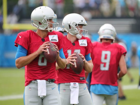 Lions quarterbacks Matt Cassel and Jake Rudock go through drills during practice during training camp on Wednesday, Aug. 1, 2018, in Allen Park.
