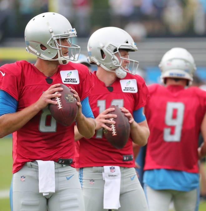 Lions quarterbacks Matt Cassel and Jake Rudock go through drills during practice during training camp on Wednesday, Aug. 1, 2018, in Allen Park.