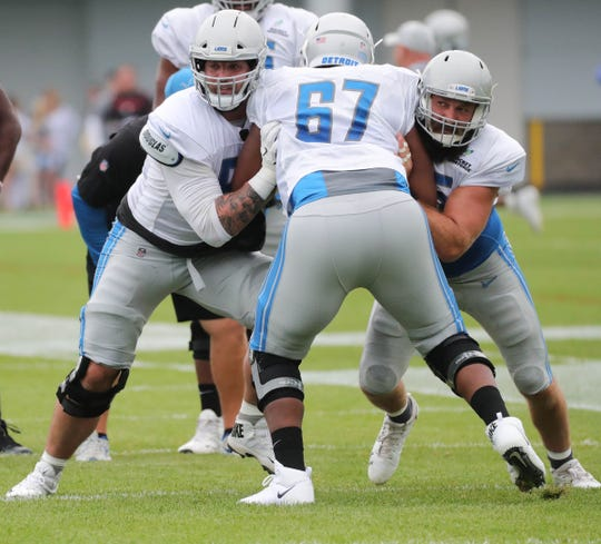 Lions offensive linemen Taylor Decker and Leo Koloamatangi block Jamar McGloster during practice during training camp on Wednesday, Aug. 1, 2018, in Allen Park.