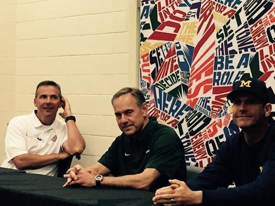 Ohio State football coach Urban Meyer, left, Michigan State coach Mark Dantonio and University of Michigan coach Jim Harbaugh share a moment the Sound Mind Sound Body camp in June 2015.