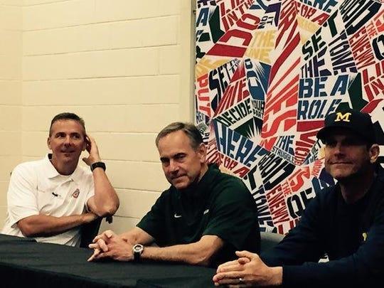 Ohio State football coach Urban Meyer, left, Michigan State coach Mark Dantonio and University of Michigan coach Jim Harbaugh share a moment the Sound Mind Sound Body camp in June 2015.