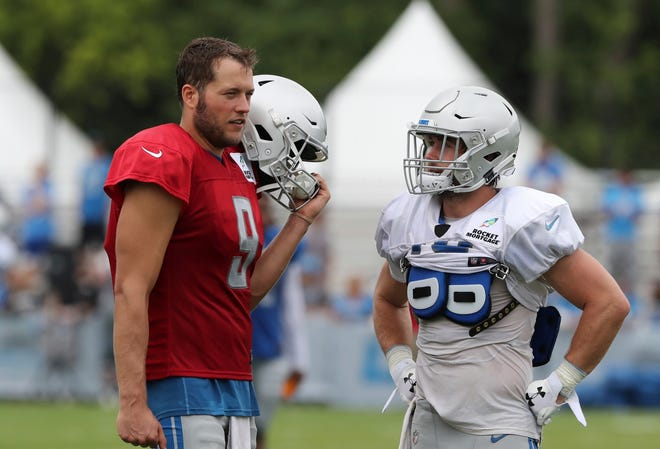 Lions quarterback Matthew Stafford, left,talks with receiver Jace Billingsley after practice during training camp on Wednesday, Aug. 1, 2018, in Allen Park.