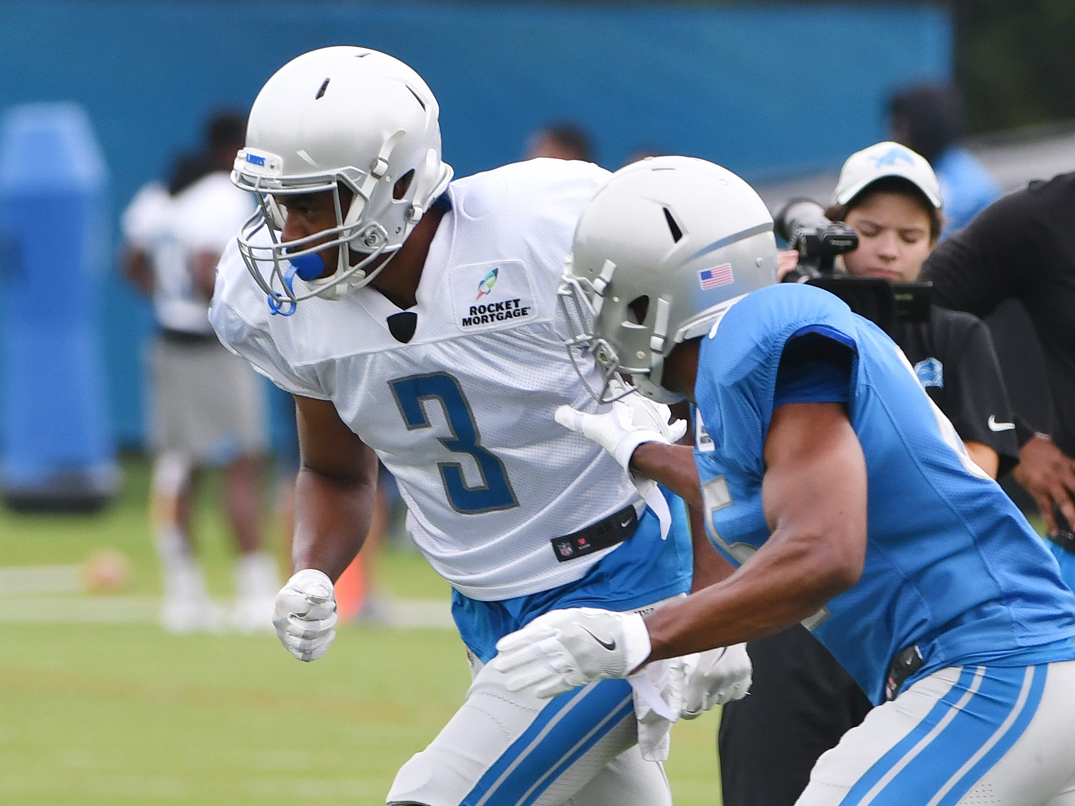 Lions wide receiver Dontez Alexander and safety Charles Washington work during a drill involving bursting off the line of scrimmage against a defender.
