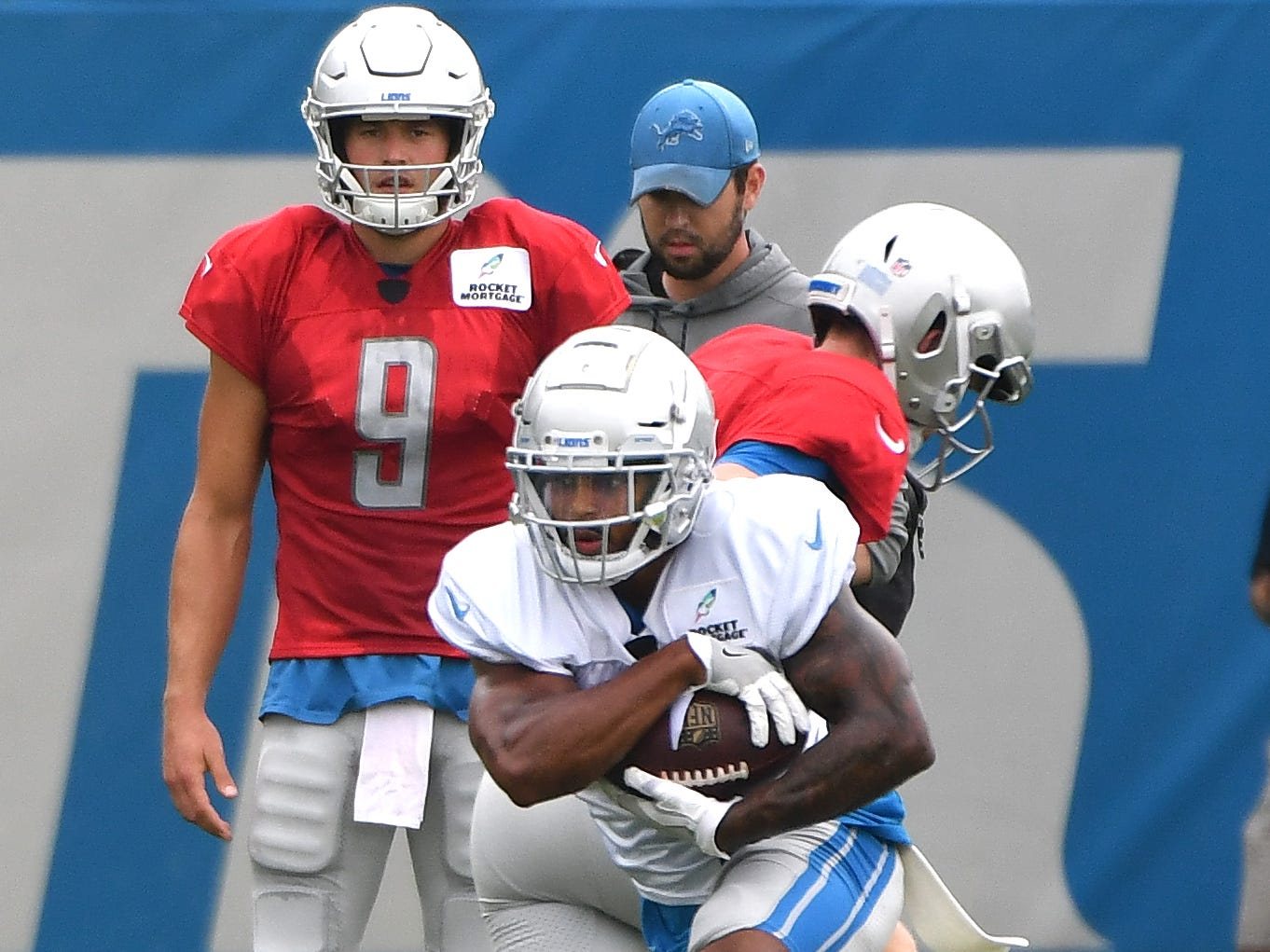 Lions running back Ameer Abdullah takes the handoff from quarterback Jake Rudock.