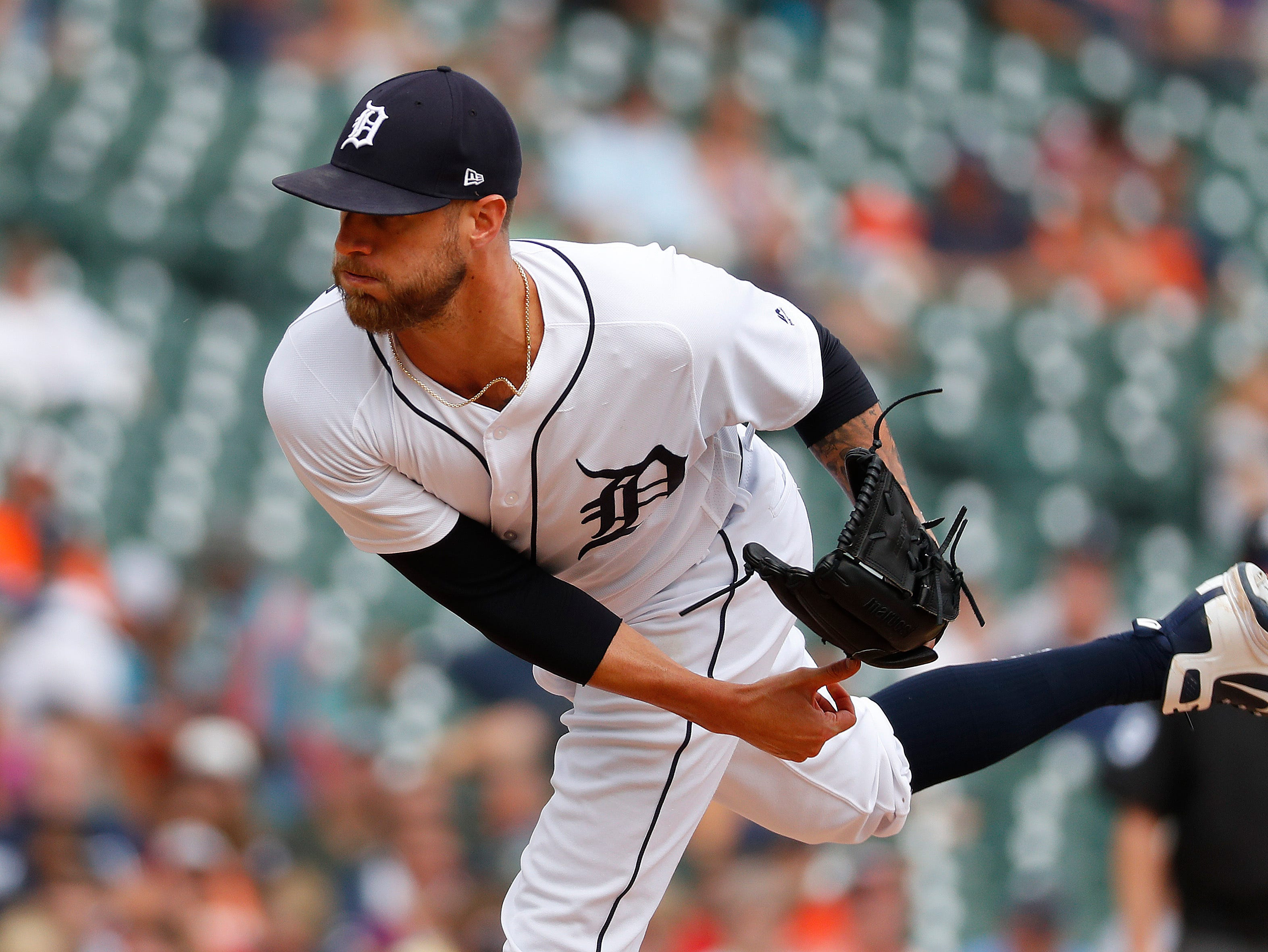 Tigers relief pitcher Shane Greene throws against the Cincinnati Reds in the ninth inning.