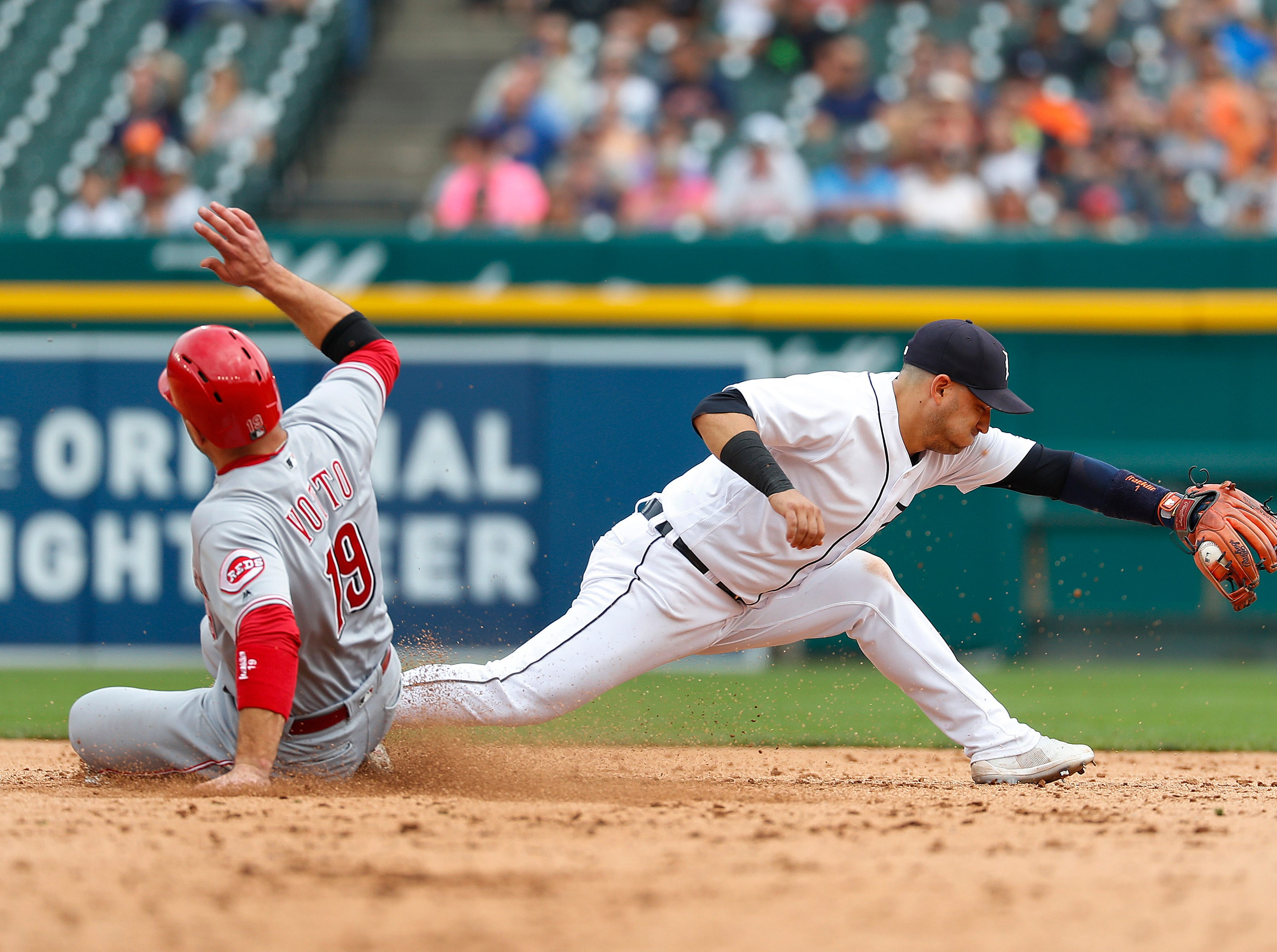 Tigers shortstop Jose Iglesias catches the ball at second base for the out as Cincinnati Reds' Joey Votto slides late in the eighth inning.