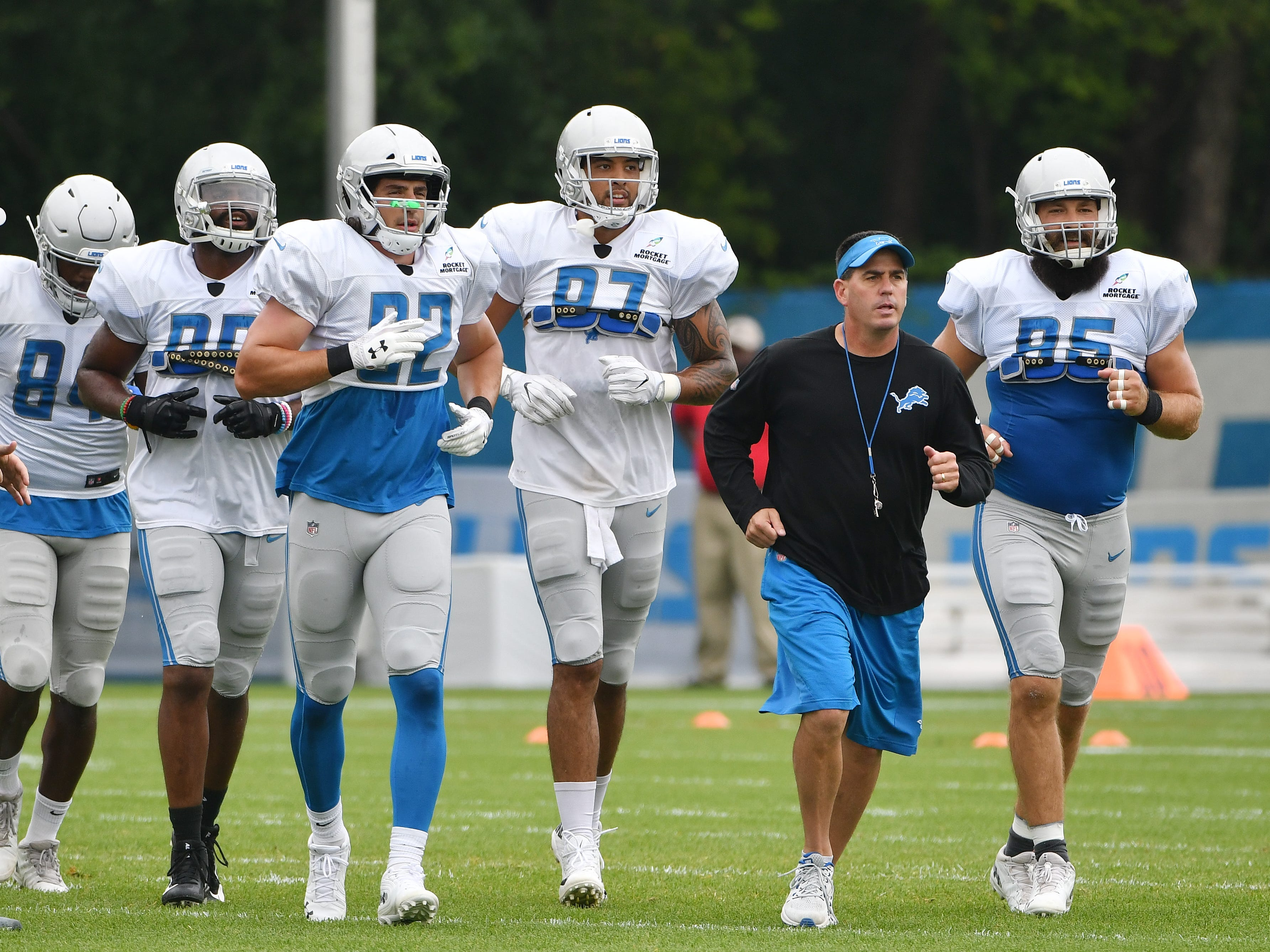 Lions tight end coach Chris White and his players head over to the next drill.