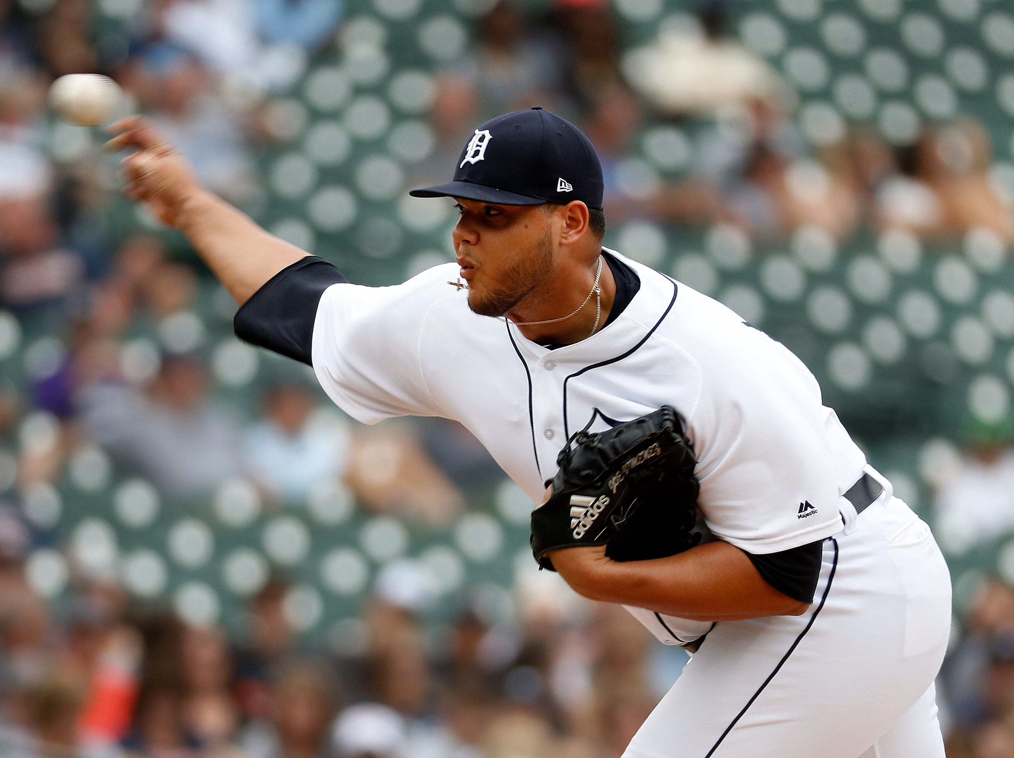 Tigers relief pitcher Joe Jimenez throws against the Cincinnati Reds in the eighth inning.