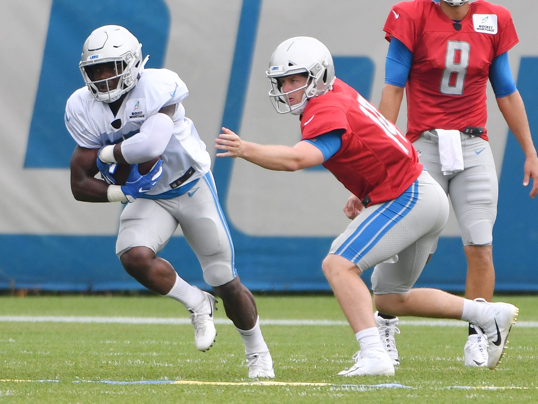 Lions running back Theo Riddick takes the handoff from quarterback Jake Rudock.