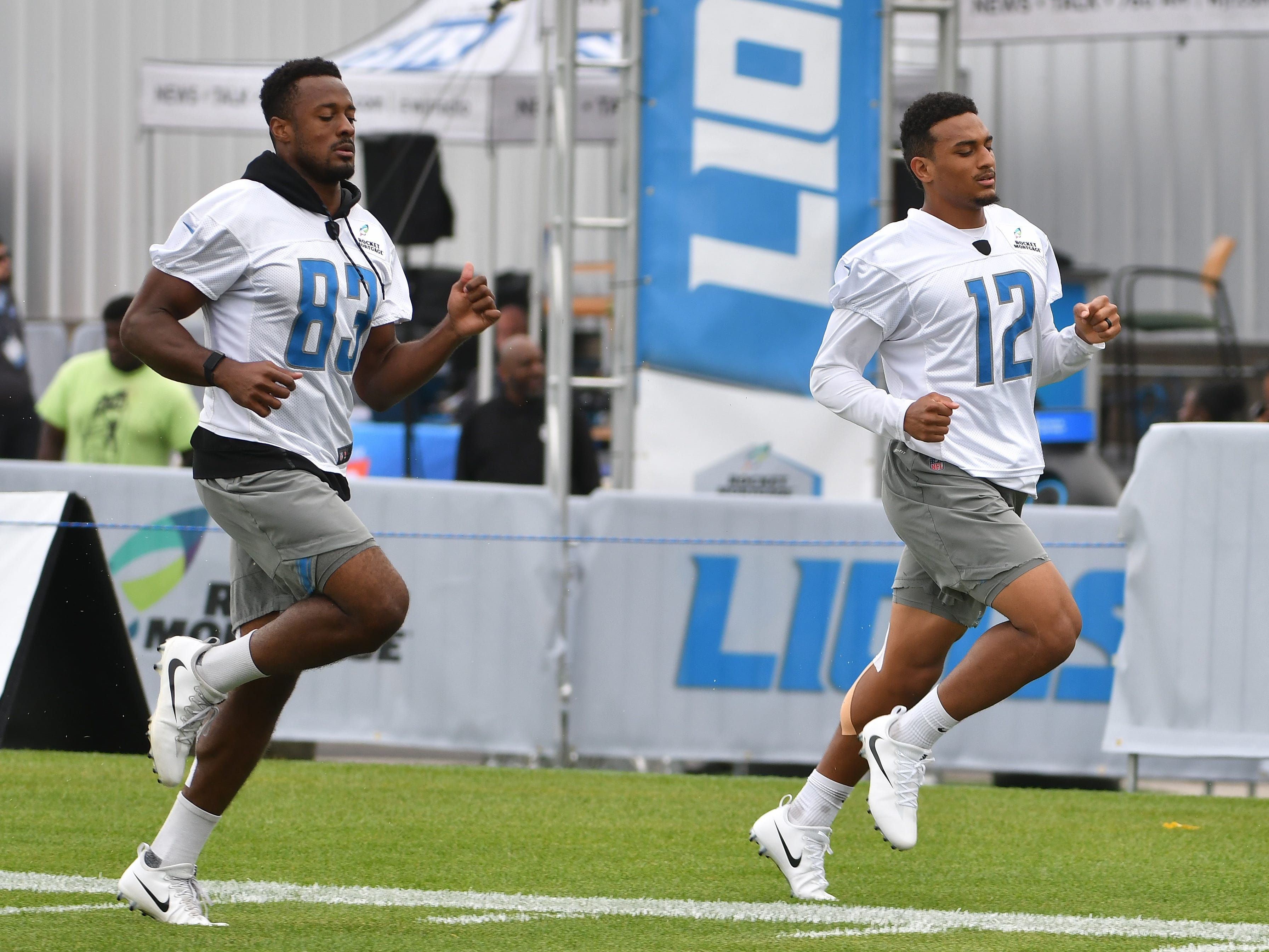 Lions wide receiver Dontez Ford and Bradley Marquez run during practice but did not participate in drills.