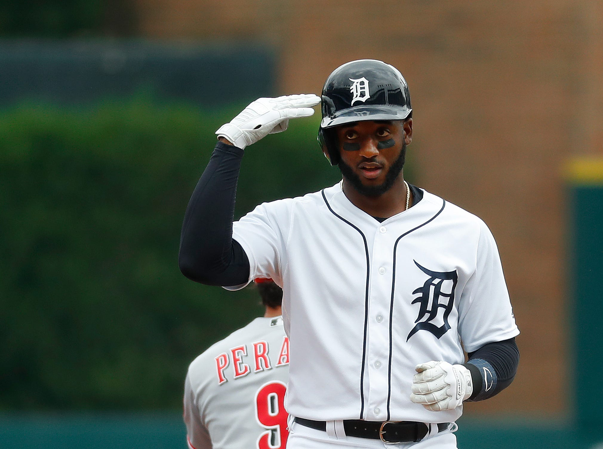 Detroit Tigers' Niko Goodrum reacts to hitting a double in the first inning.