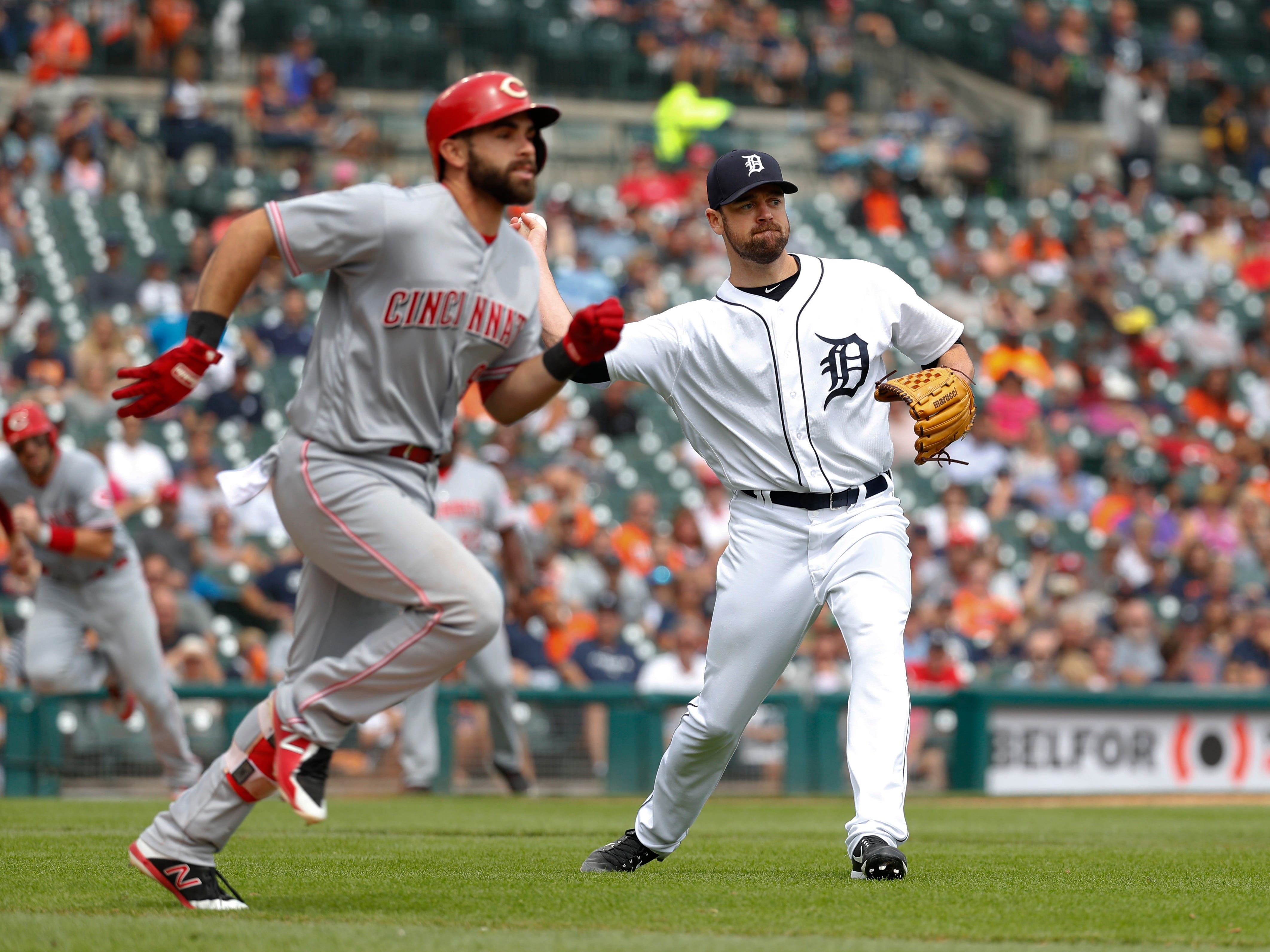 Tigers relief pitcher Louis Coleman throws out Cincinnati Reds' Jose Peraza  at first base in the seventh inning.