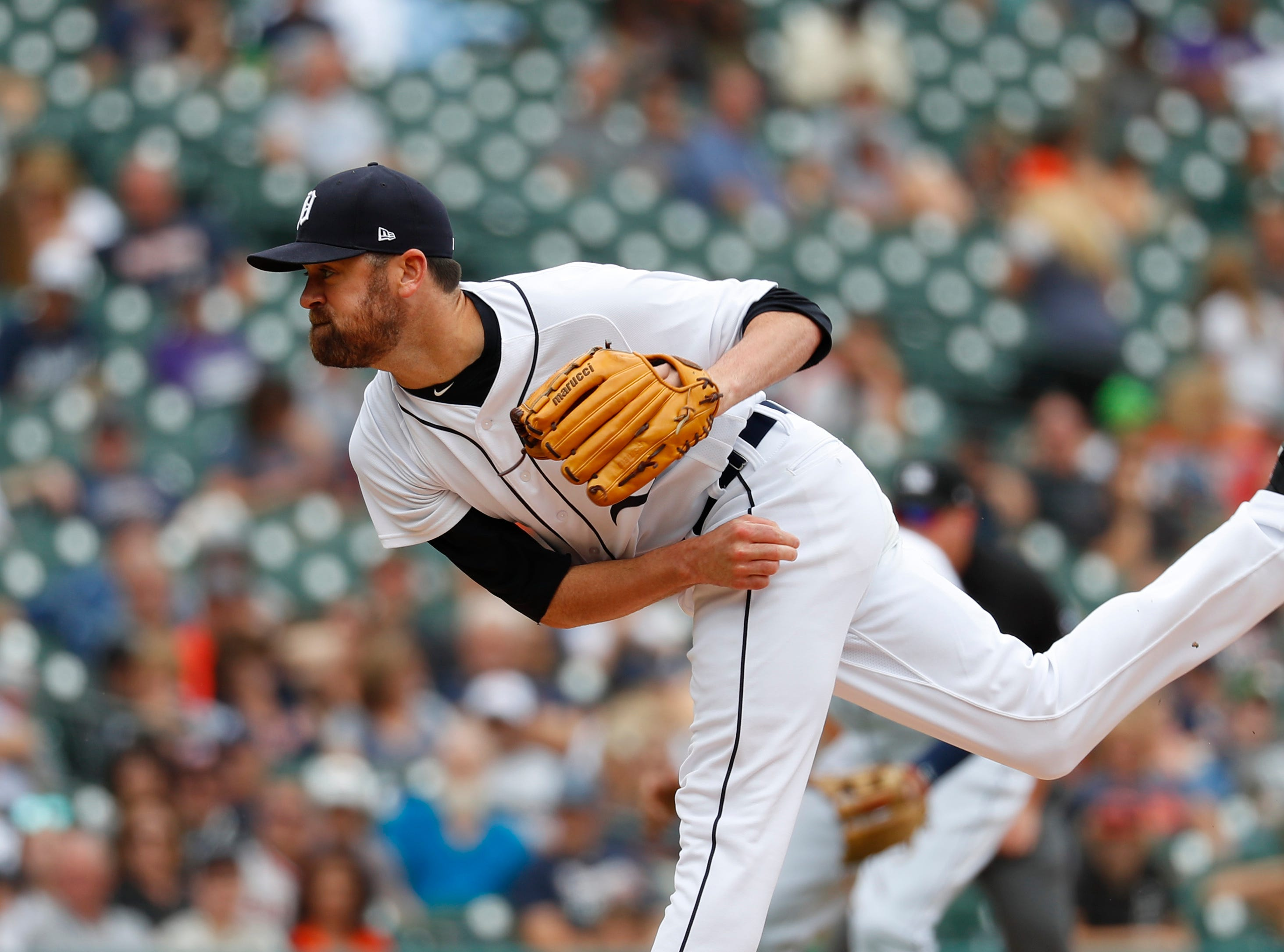 Tigers relief pitcher Louis Coleman throws against the Cincinnati Reds in the seventh inning.