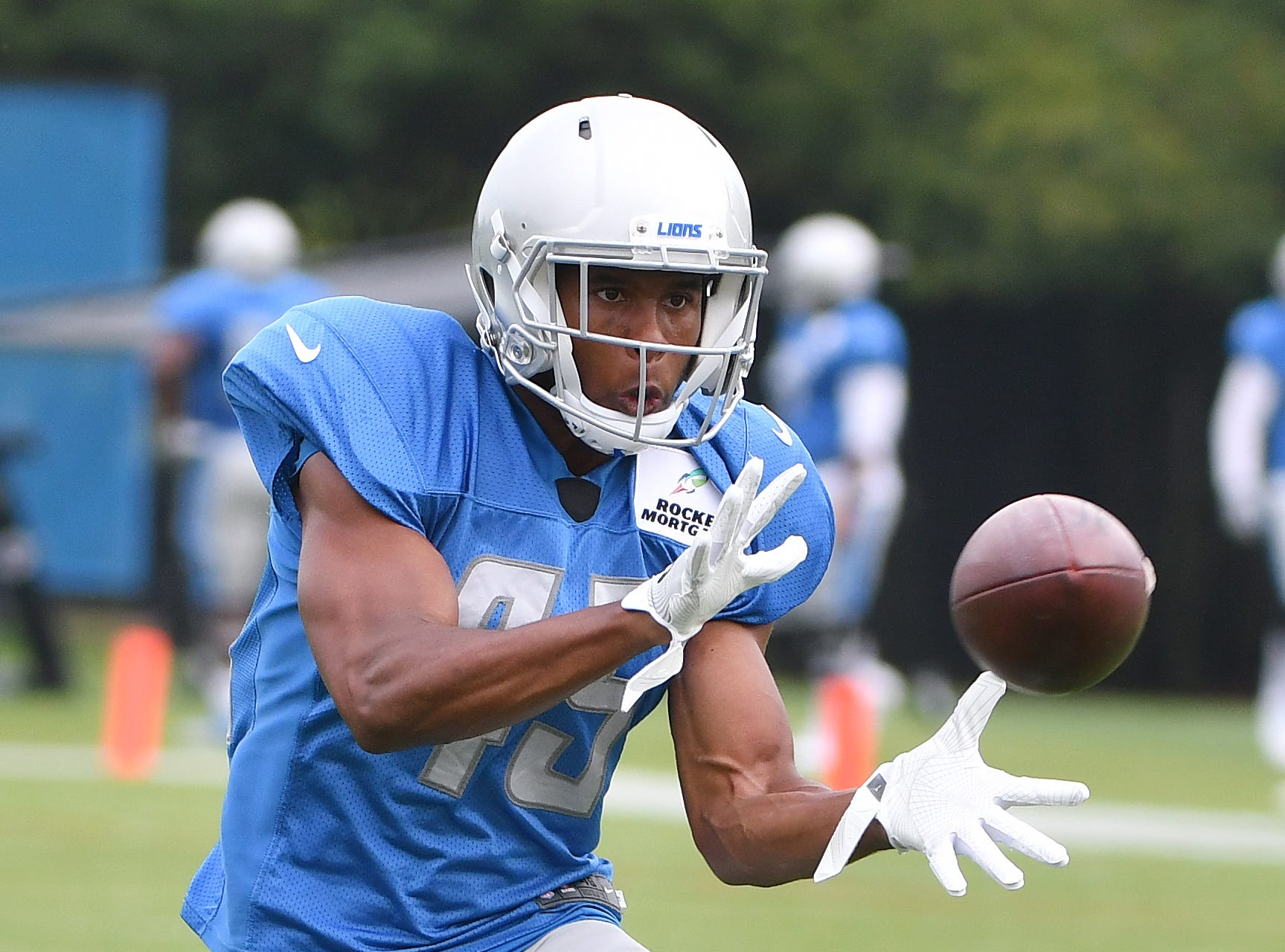 Lions safety Charles Washington pulls in a reception during drills