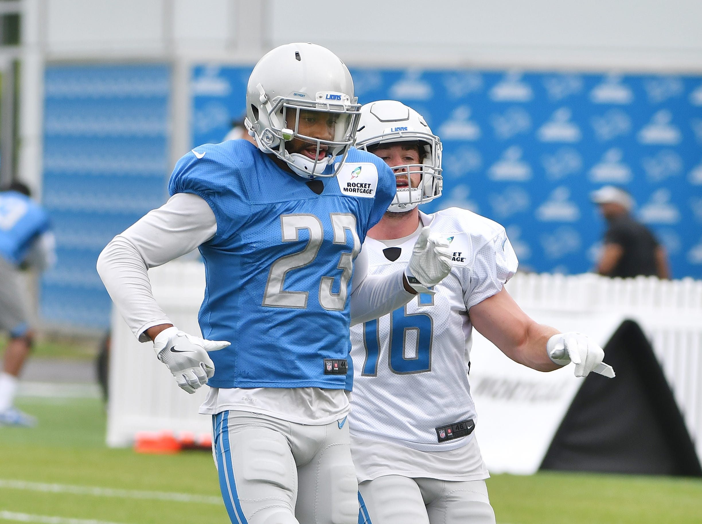Lions cornerback Darius Slay and wide receiver Jace Billingsley work during a drill involving bursting off the line of scrimmage against a defender.