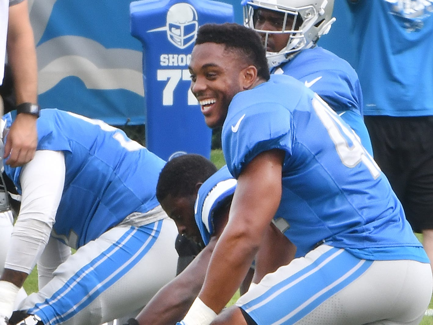 Lions linebacker Devon Kennard goes though stretching with the team.