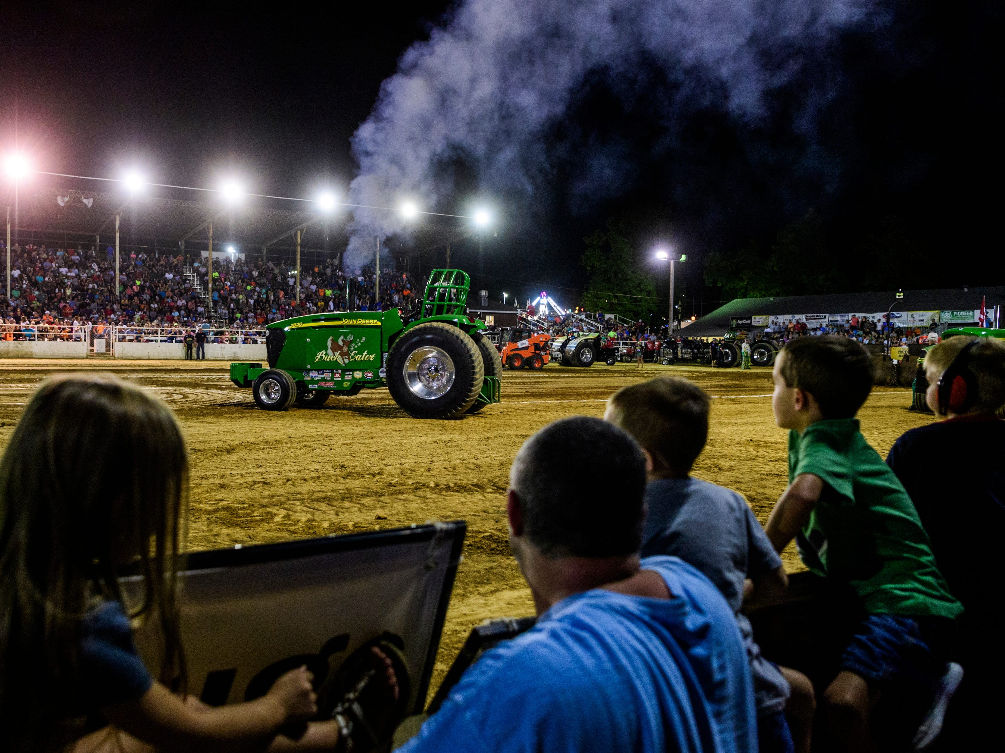 The grandstands are bursting at the seams with people of all ages watching the Lucas Oil Pro Pulling League Professional Tractor Pull event at the Vanderburgh County Fair grandstand, Friday evening, July 27, 2018.