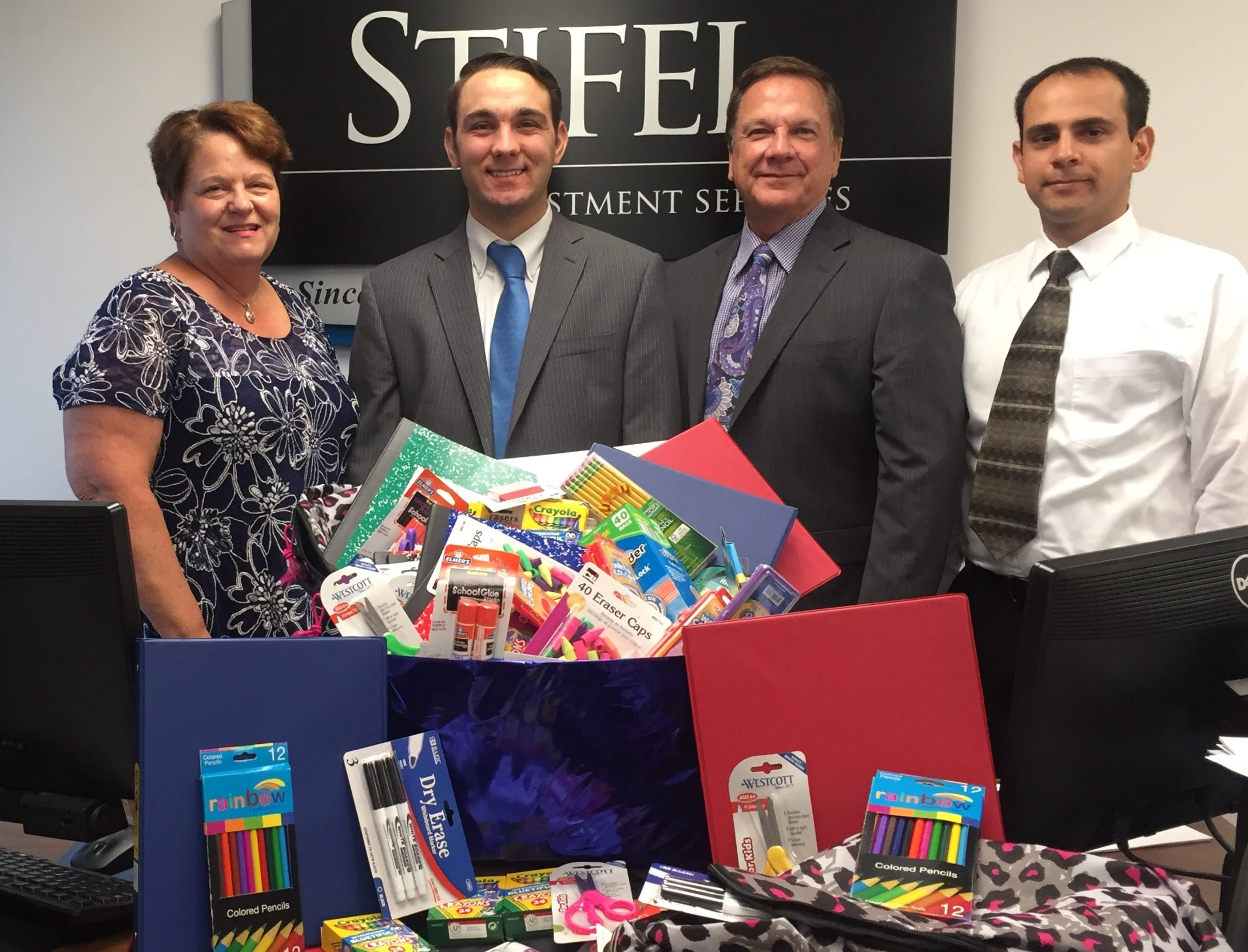 BACK TO SCHOOL - Stockwell Elementary students and staff were the recipients of back to school supplies from Stifel Ruder Investment Group. Financial Advisor Bryan Ruder attended Stockwell and continues provide needed school items each year. Members of the firm pictured are Sharon Ruder, Bryan Ruder, Thomas Ruder and Robert Kozsan.