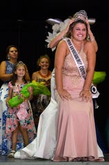 Lauren Ziliak of Haubstadt bends down to be crowned the 2018 Miss Vanderburgh County by Holly Witten, the 2017 winner, during opening night of the Vanderburgh County Fair, Monday night, July 23, 2018.