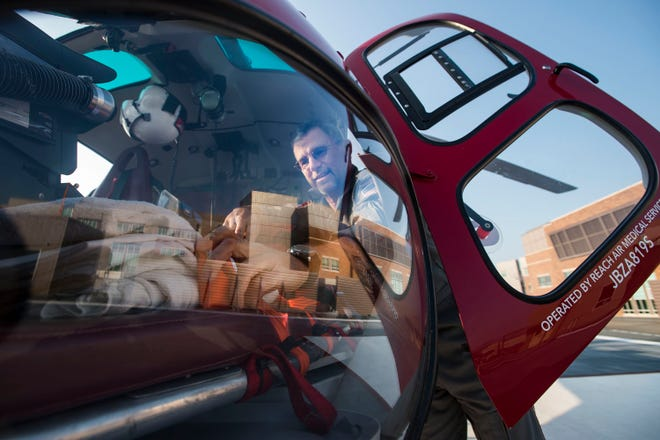 UCHealth flight paramedic Gary Davis takes inventory of the supplies on the LifeLine helicopter on Wednesday, Aug. 1, 2018, at the UCHealth Medical Center of the Rockies in Loveland, Colo.