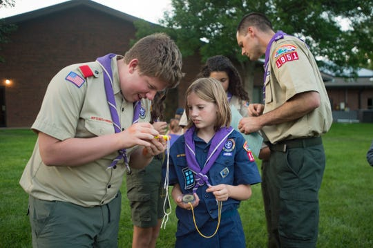 Dylan Sanford works with Robin Schauerhamer during an orienteering lesson with Troop 195 at Trinity Lutheran Church on Tuesday, July 31, 2018.