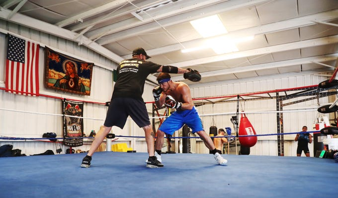 Bryant Perella 15-1 trains with his head trainer Mike Nowling at Syndicate Boxing Club in south Fort Myers on Monday. He is fighting former welterweight champion Luis Collazo, 37-7 (20 KO's), August 4 at the Nassau Coliseum in Uniondale, NY.