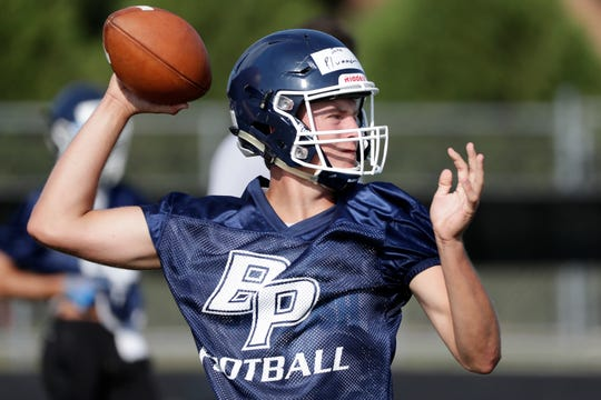 Bay Port's Jake Plummer practices on the first day of football practice Wednesday. The senior is one of the candidates to start at quarterback for the Pirates.