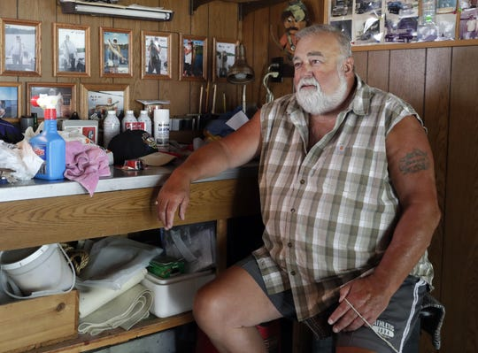 John Wenzel sits in the garage workshop of his house  at 734 John Street in Green Bay. Carroll Dale, a wide receiver for the Packers from 1965 to 1972, rented the house while he was on the team.